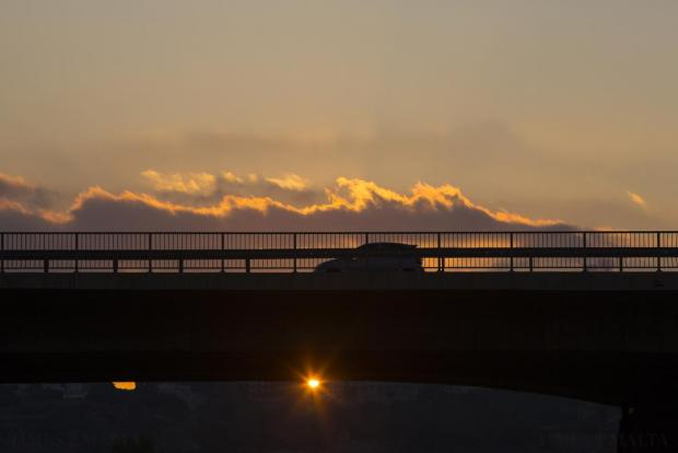Vehicles cross the Regional Road bridge in St Julian's at sunset on August 30. Photo: Darrin Zammit Lupi