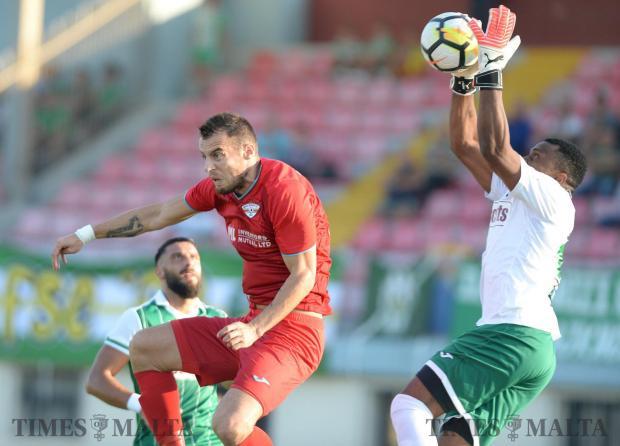 Floriana goal keeper Ini Etim Akpan beats Balzan's Bojan Kaljevic to the ball during their BOV Premiership match at the Centenary Stadium in Ta'Qali on October 14. Photo: Matthew Mirabelli