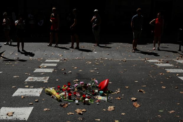 An impromptu memorial site on Las Ramblas in Barcelona. Photo: Reuters
