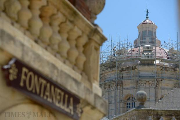 The Mdina Metropolitan Cathedral is receiving a much-needed facelift. Also in the photo is the sign of the famous Fontanella cafe, synonymous with the Silent City and delicious, mouth-watering cakes as seen on August 16. Photo: Matthew Mirabelli