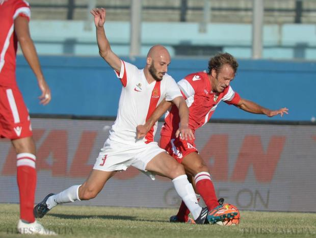 Valletta 's Ian Azzopardi (left), and Naxxar's Luca Lodetti tangle for possession at the National Stadium in Ta'Qali on September 27. Photo: Matthew Mirabelli