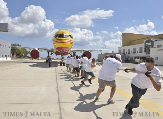 Groups of men (and some women) enjoyed themselves trying to pull a plane in a fund-raiser for Puttinu Cares at the Aviation Park in Safi on September 21. Photo: Mark Zammit Cordina