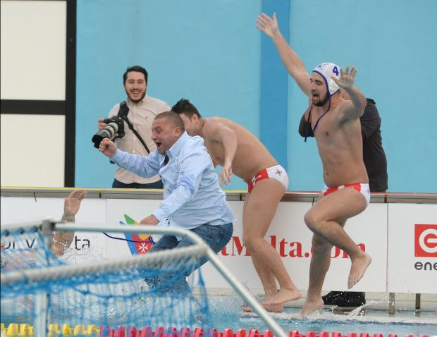 Malta players push national water polo coach Karl Isso into the pool after winning their European Water Polo Championship play-off match against Belarus at the National Pool in Tal Qroqq on March 3. Photo: Matthew Mirabelli