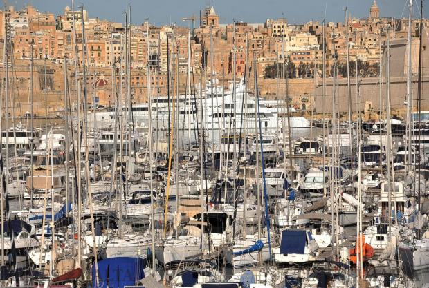 A super yacht can be seen berthed under St Angelo through a forest of sail boat masts in Vittoriosa on February 8. Photo: Chris Sant Fournier