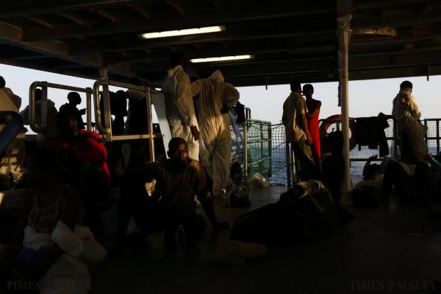 Rescued migrants rest on the deck of the Migrant Offshore Aid Station (MOAS) ship MV Phoenix between Libya and the Italian island of Lampedusa, on August 3. 118 migrants were rescued by the Phoenix from a rubber dinghy some 32 kilometres off the coast of Libya on Monday morning. The Phoenix, manned by personnel from international non-governmental organisations Medecins san Frontiere (MSF) and MOAS, is the first privately funded vessel to operate in the Mediterranean. Photo: Darrin Zammit Lupi