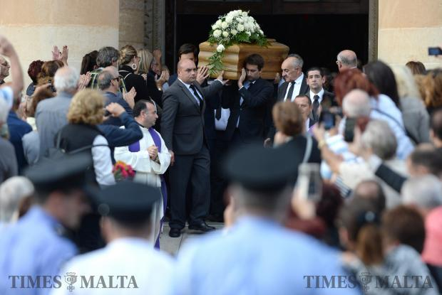 The sons of murdered blogger Daphne Caruana Galizia, Matthew (right) and Andrew (left), carry the coffin of their mother out of the church in Mosta, on November 3, after her funeral ceremony. Photo: Matthew Mirabelli
