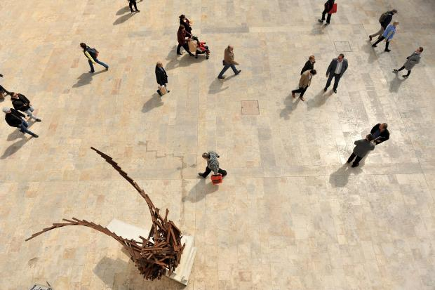 People walk past a sculpture in Republic Street Valletta on April 16. Photo: Chris Sant Fournier