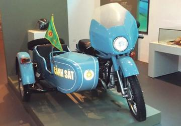 A light blue Russian motorcycle with sidecar at the Hanoi Military Museum.