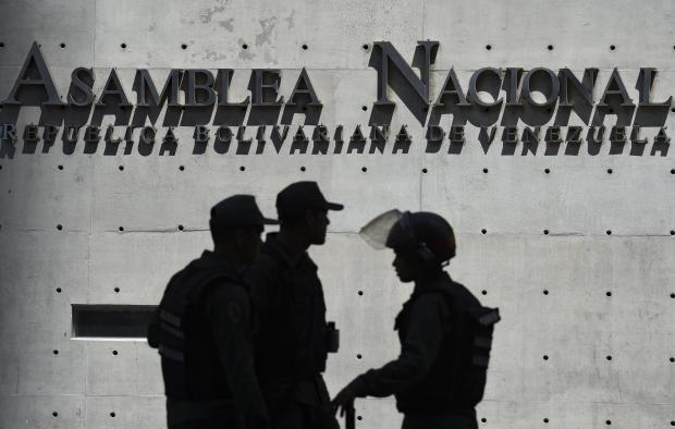 Members of Venezuela's Bolivarian National Guard block access to the Federal Legislative Palace, which houses both the opposition-led National Assembly and the pro-government National Constituent Assembly, in Caracas.