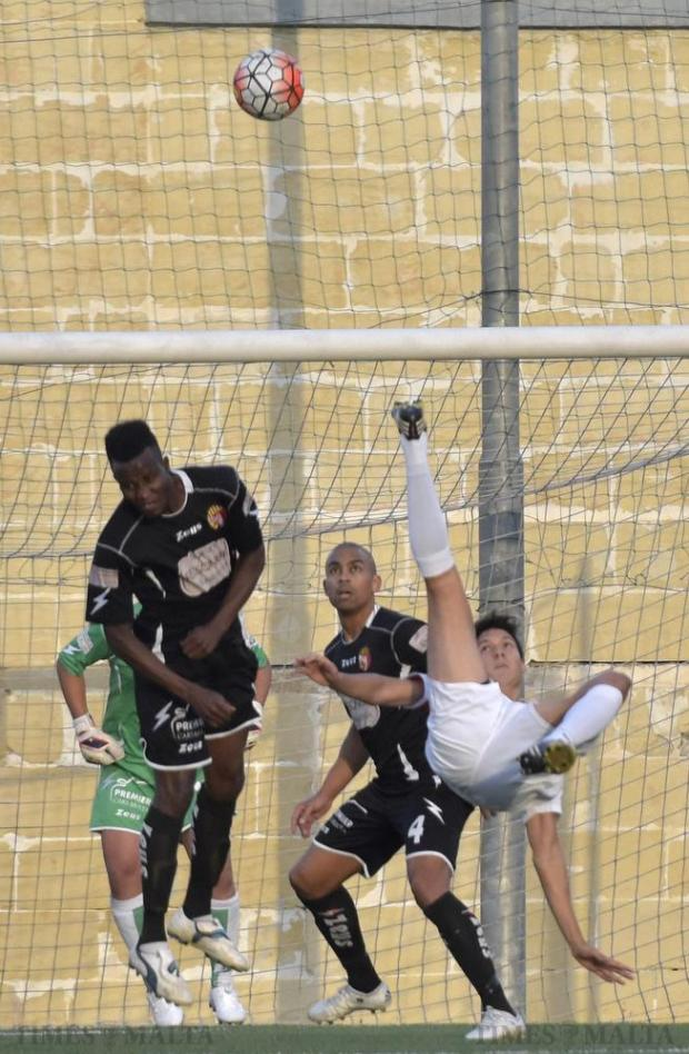 Federico Falcone (right) acrobatically scores Valletta's opening goal against Qormi during their Premier League football match at the Tedesco Stadium in Hamrun on October 24. Photo: Mark Zammit Cordina