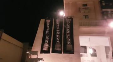 Banners highlight 'crumbling pillars of democracy'