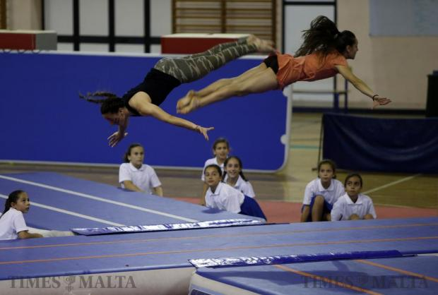 Gymnasts leap through the air during the Malta Gymnastics Club's annual event, Gymfest, at the University Sports Complex in Tal-Qroqq on June 5. Some 500 gymnasts, aged between 5 and 16, from 12 schools participated in the event, showcasing their physical abilities with their performances. Photo: Darrin Zammit Lupi
