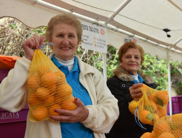 Volunteers at the Citrus fest hold up oranges at San Anton Gardens on January 14. Photo: Mark Zammit Cordina