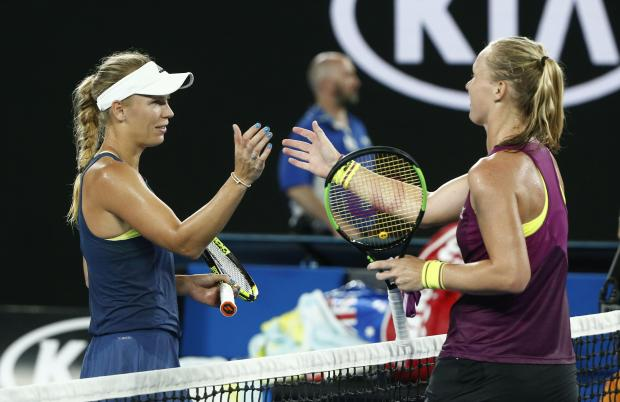 Denmark's Caroline Wozniacki shakes hands with Netherlands' Kiki Bertens after Wozniacki won their match.