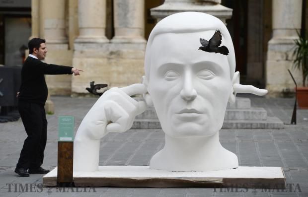 A man points at one of the polystyrene sculptures which forms part of the Valletta 2018 project Kif Jgħid il-Malti (According to Maltese Sayings) in Republic Square, Valletta on February 5. The sculpture is an adaptation of the saying Minn waħda jidħol u mill-oħra joħroġ (In one ear and out the other). Photo: Matthew Mirabelli
