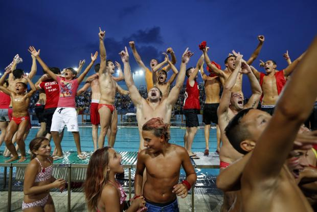 Players, officials and fans celebrate after Neptunes won their 22nd waterpolo league title by beating San Giljan 9-7 at the National Pool on September 3. Photo: Darrin Zammit Lupi