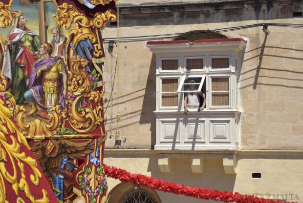 An elderly man looks out of his balcony during the feast of St Helen's in Birkirkara on August 22. Photo: Mark Zammit Cordina