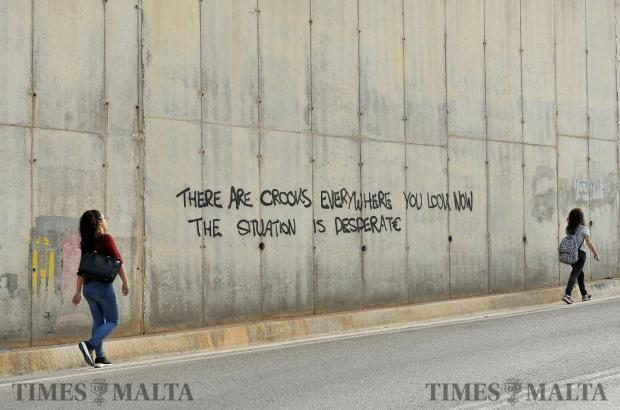 The last words of investigative journalist Daphne Caruana Galizia are sprayed on a wall near the University the day after her assassination October 17. Photo: Chris Sant Fournier