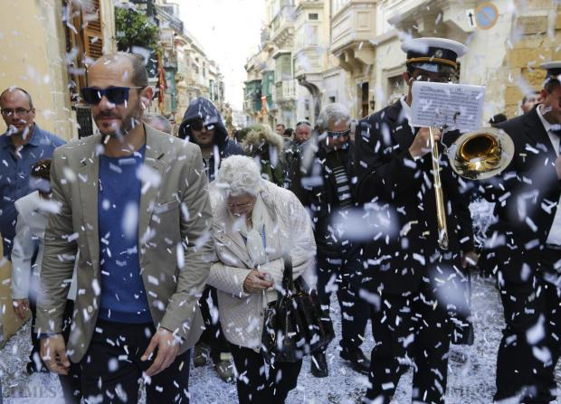 Confetti streams down over worshippers and bandsmen during an Easter Sunday procession in Cospicua on April 5. Photo: Darrin Zammit Lupi