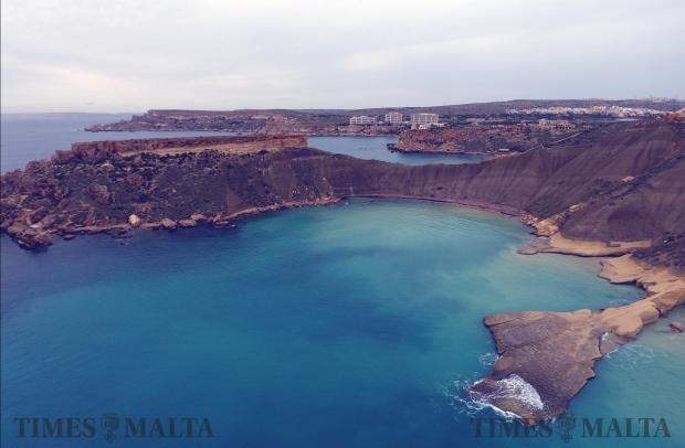 The water at Ġnejna Bay had a different tinge on November 11 after the heavy storms of the past few days led to a run-off of rainwater into the sea. Photo: Mark Zammit Cordina