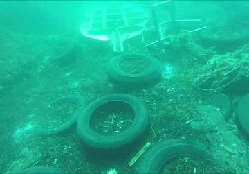 Watch: Plastic galore and even metal barriers await divers for St Paul's Bay clean-up