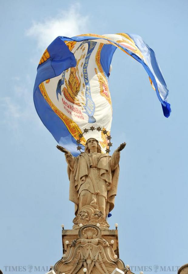 The statue of Santa Marija stands atop the King George V Band club in Mqabba on August 15. Photo: Chris Sant Fournier