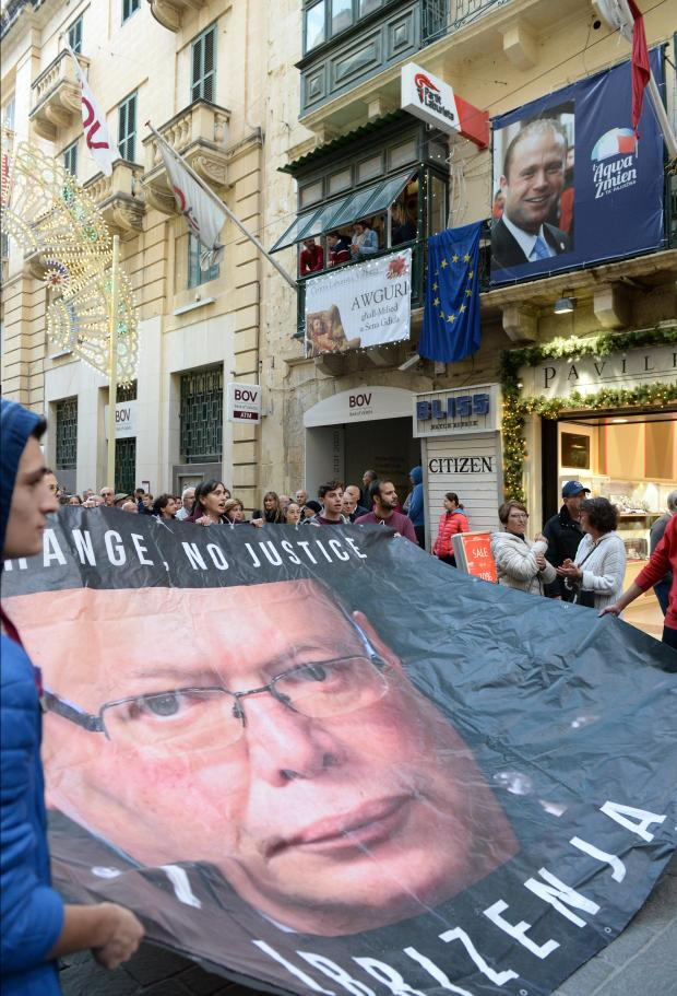 People walk with banners during a demonstration organized by the Civil Society Network in Valletta on December 3. Photo: Matthew Mirabelli