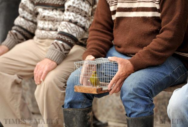 A man holds a bird cage in Qrendi on March 9. Photo: Chris Sant Fournier