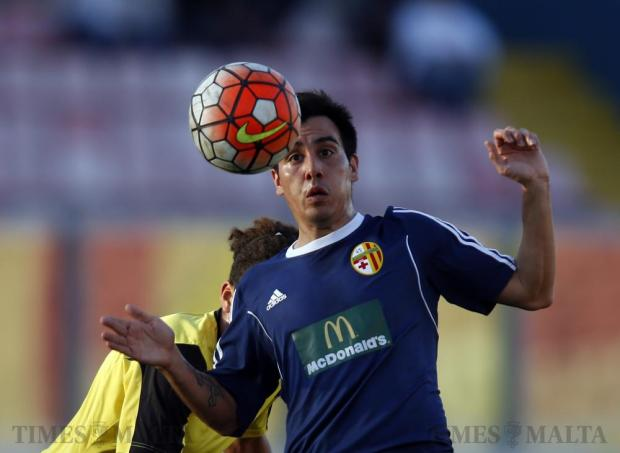 Birkirkara's Edison Zarate defends possession of the ball from Qormi's Yannick Yankam (partly hidden) during their Premier League football match at the National Stadium in Ta' Qali on January 10. Photo: Darrin Zammit Lupi