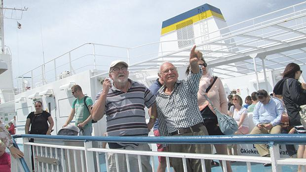 Capt. Alan Everett (left) with his long-time friend Francis Mazzelli on the ferry to Gozo a few months before his demise. Photo: Paul Worthington