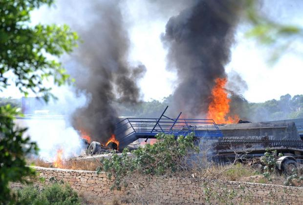 Wood and tyres go up in flames at a property owned by developer Charles Polidano in Hal-Farrug on August 27. Photo: Chris Sant Fournier