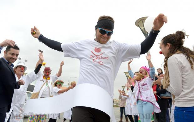 Chris Mamo, who lost his sister Tania Faye to cancer, completes his 20 marathons in 20 days on April 7 to raise funds for beds to be used by the parents of hospitalized children. Photo: Matthew Mirabelli