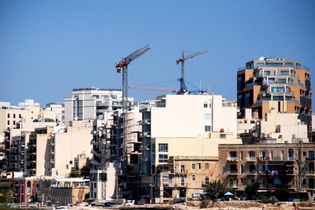 Cranes tower over buildings in St Julian's on June 13. Photo: Mark Zammit Cordina