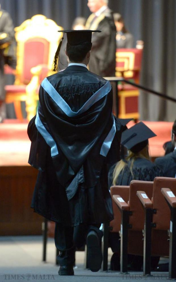 A graduate makes his way into the hall after graduating in Business and Information Technology at the University of Malta on November 23. Photo: Matthew Mirabelli