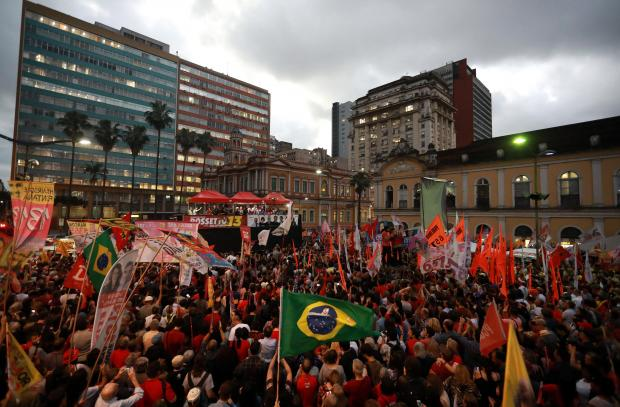 Supporters of presidential candidate Fernando Haddad of the Workers Party (PT) Supporters of presidential candidate Fernando Haddad of the Workers Party (PT) at a rally in Porto Alegre. Photo: Reuters