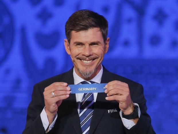 FIFA official Zvonimir Boban performs the drawing.
