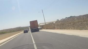 Watch: Truck in dangerous manouevre, road grating caves in....
