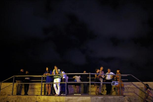 Visitors stand on a gun emplacement at Fort St Elmo during Notte Bianca (White Night) celebrations in Valletta on October 3. Photo: Darrin Zammit Lupi