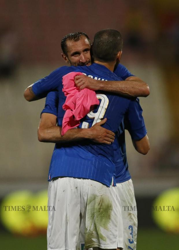 Italy's Giorgio Chiellini and Leonardo Bonucci embrace after the friendly football match against Scotland at the National Stadium in Ta'Qali on May 29. Photo: Darrin Zammit Lupi