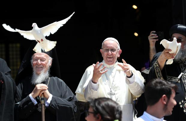 Pope Francis frees a dove during a meeting with Patriarchs of the churches of the Middle East in the St. Nicholas Basilica in Bari.