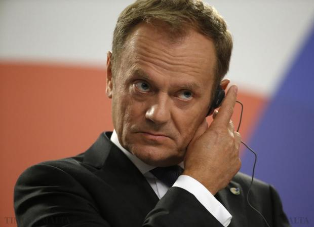 European Council President Donald Tusk adjusts his ear piece during a joint press conference with Maltese Prime Minister Joseph Muscat and President Macky Sall of Senegal at the end of the Valletta Summit on Migration in Valletta on November 12. Photo: Darrin Zammit Lupi