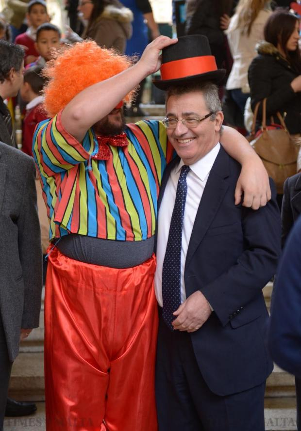 A clown jokes with Education Minister Evarist Bartolo during the launch of this year's Bicycle Marathon at St George's Square in Valletta on January 22. Now an annual event, the three-day marathon involves students of the San Ġorġ Preca College Boys' Secondary Ħamrun, past pupils, their relatives and friends taking part in the 50-hour fundraiser. Photo: Matthew Mirabelli