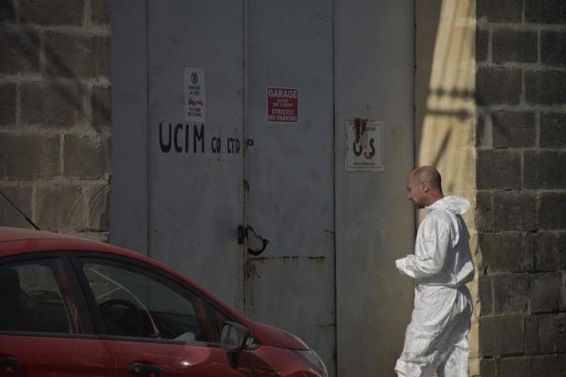 A forensics police officer enters the garage where the body of murder victim Eleonora Mangion Walker was found in Qormi on July 4. Photo: Mark Zammit Cordina.