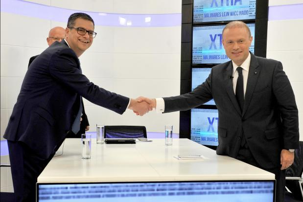 Adrian Delia and Joseph Muscat shake hands before filming the first televised debate between them. Photo: Chris Sant Fournier