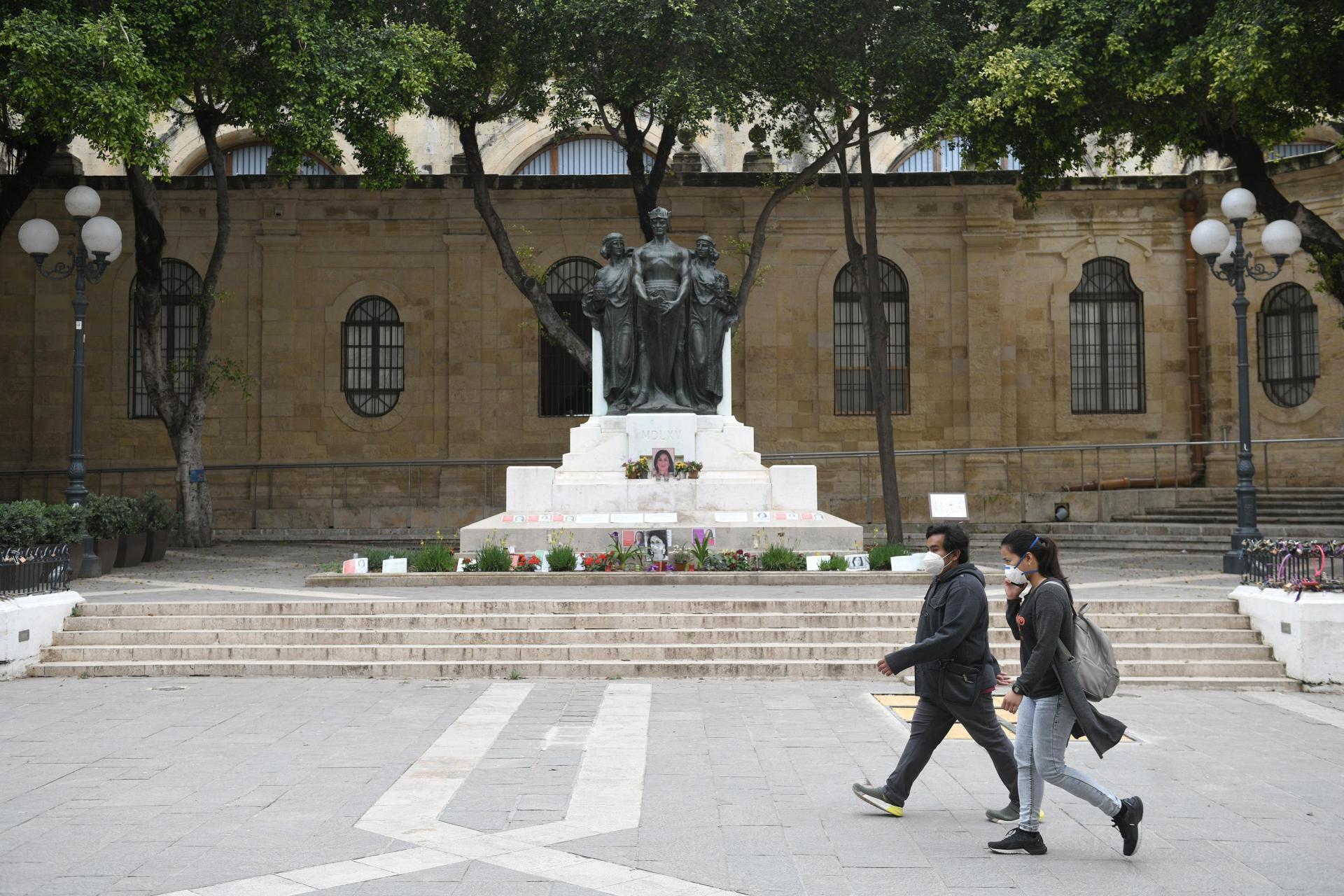 People walk past Daphne Caruana Galizia's mural in Valletta earlier this week. Photo: Matthew Mirabelli