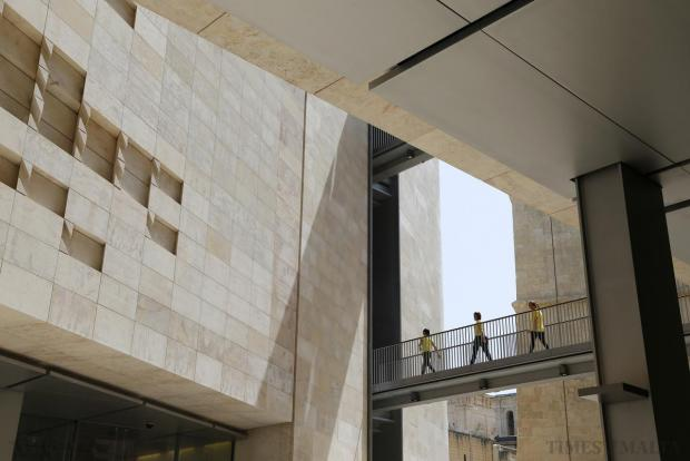 Cleaning staff cross the bridge between the two buildings at the newly inaugurated Parliament House in Valletta on May 6. Photo: Darrin Zammit Lupi