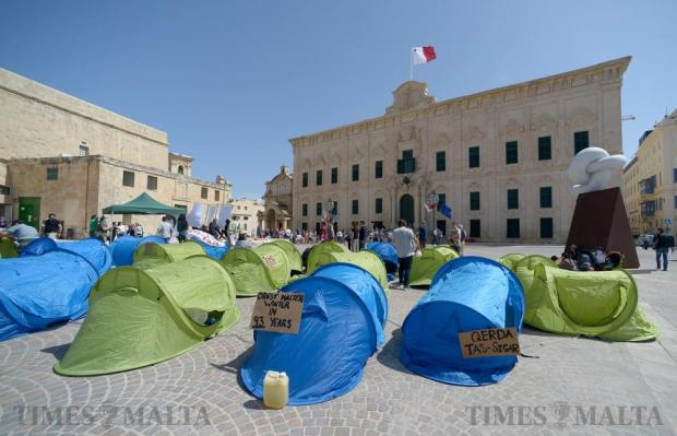 Tents are erected during a protest 'camp' outside Auberge de Castille on May 14. The protest, organised by Moviment Graffitti, called for an end to environmental degradation. Photo: Matthew Mirabelli