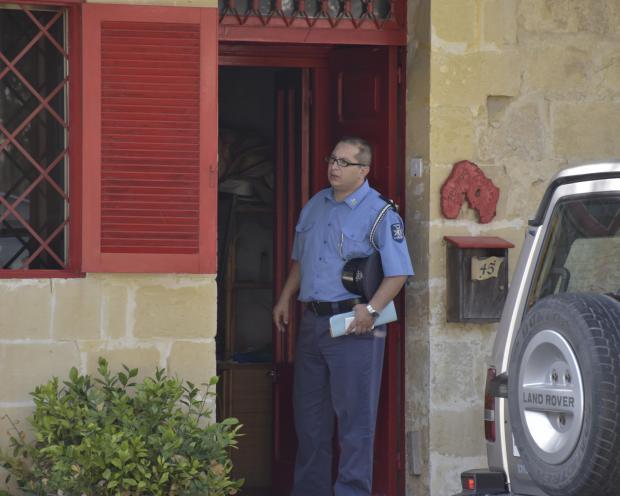 A policeman at the scene of the crime. Photo: Mark Zammit Cordina.