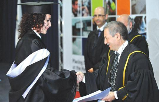 Mcast principal Maurice Grech presenting a certificate to one of the graduates, yesterday. Photo: Chris Sant Fournier