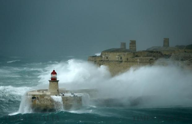 Huge waves crash against the breakwater and Fort Ricasoli at the entrance to Valletta's Grand Harbour on December 17. Photo: Darrin Zammit Lupi